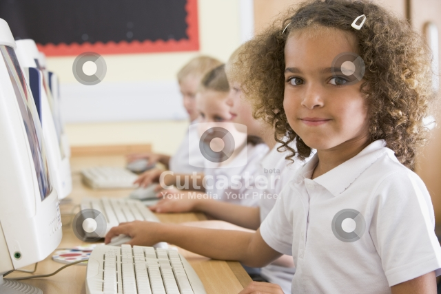 Small school child at a computer